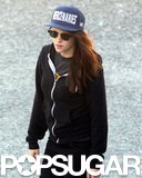 Kristen Stewart kept a low profile in a baseball cap and dark shades.