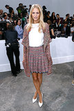 Poppy Delevingne was the epitome of ladylike in a tweed look, accented with pops of stark white at the Chanel show.