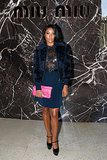 Gabrielle Union used a bright pink Miu Miu clutch to liven her navy ensemble at the Miu Miu Spring 2014 show in Paris.