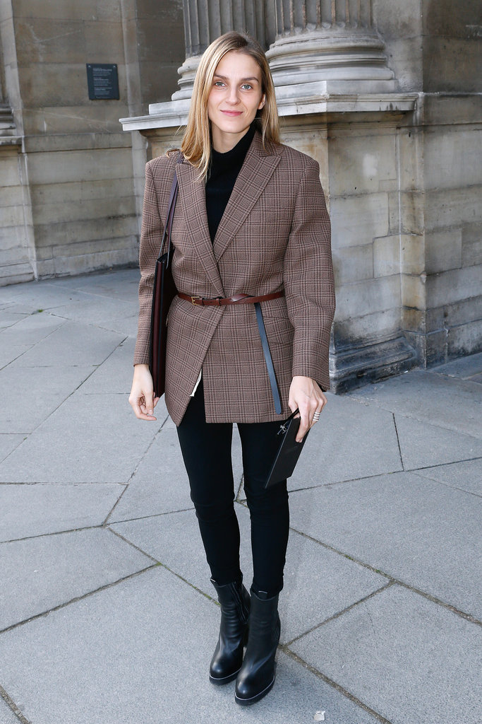 Gaia Repossi was ready for Fall in a belted blazer outside the Louis Vuitton Spring show.