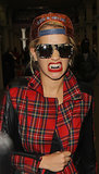 Rita Ora flashed a silver grill while walking around London.