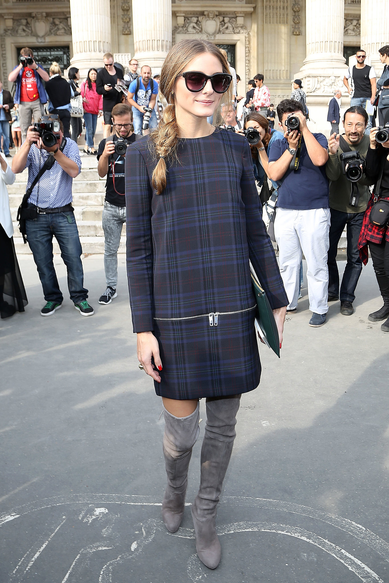 For her first appearance at Paris Fashion Week, Olivia went mad for plaid in a blue minidress from Zara.