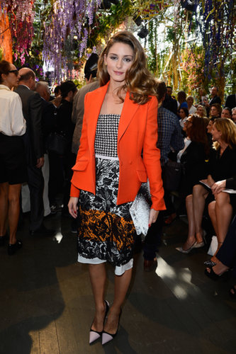 At Dior, the street style star debuted color and pattern in her boldly floral look of black, white, and orange.