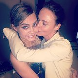 Stella McCartney planted a smooch on Cara Delevingne after finishing her Spring 2014 show in Paris. Source: Instagram user caradelevingne