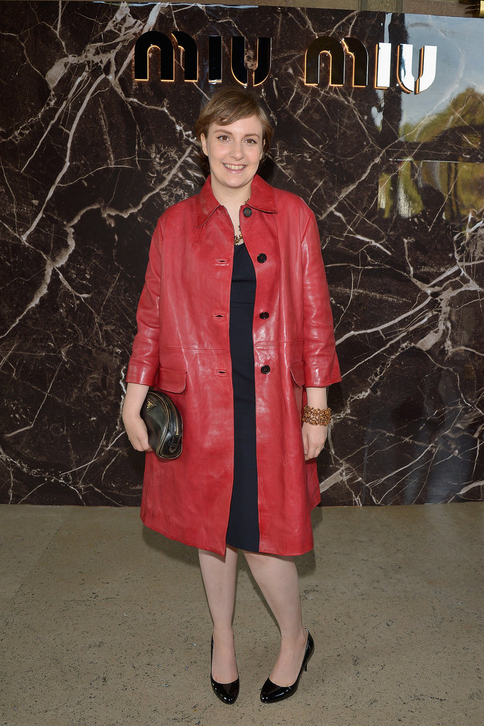 Lena Dunham rocked a head-to-toe Prada ensemble at the Miu Miu show. She started with a little black dress, then added a red leather coat, crystal jewels, a black clutch, and patent pumps.