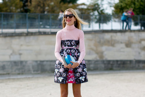 Natalie Joos perfects her sweet look with a bold pop of blue on her clutch.