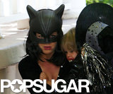 Isla Fisher and Olive headed out as Catwoman and a witch on their way to a friend's Halloween party in Hollywood in 2009.