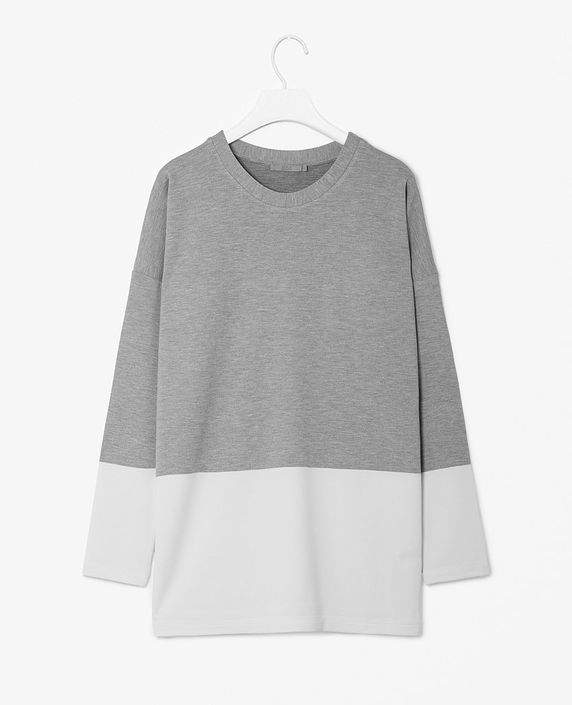 As if any girl could ever own too many comfortable jersey tops. We like this colorblock white and gray option ($79) for weekend wear.