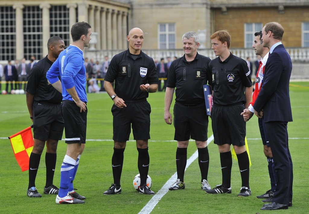 Prince William stood by during the coin toss before the game.