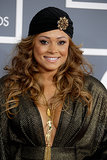 Tamia embellished her basic black turban with a gilded broach and caramel waves.