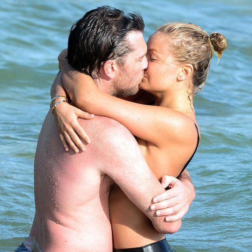 Sam Worthington and Lara Bingle Kissing in the Ocean