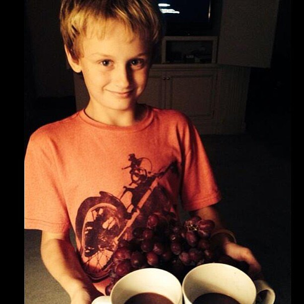 Evan Asher prepared for a night of snacking on grapes and hot chocolate with his mom, Jenny McCarthy. Source: Instagram user jennyannmccarthy