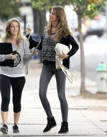 Gisele Bündchen kept warm in a knit sweater, gray skinny denim, and high-top sneakers in Boston.