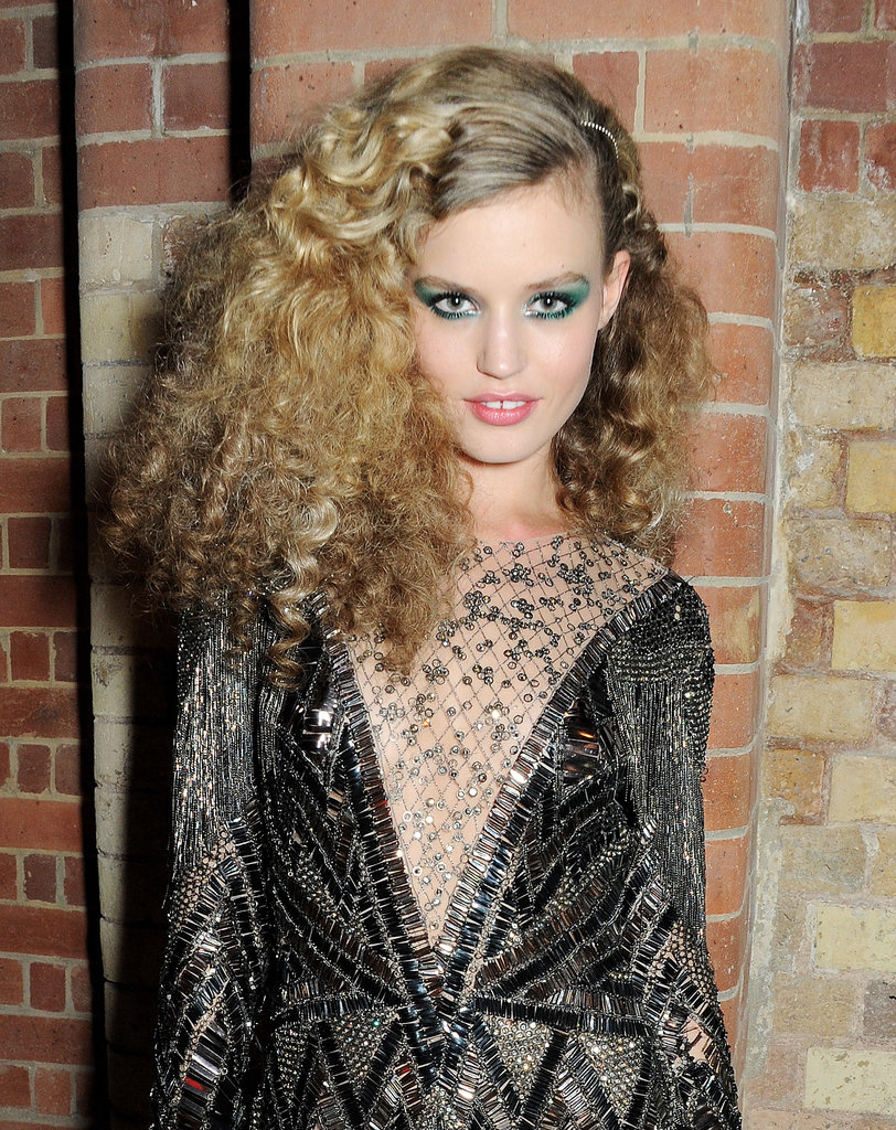 At the 180 Years of Cool party, Geogia May Jagger took a foray into '70s style with teased ringlets and flared-out, emerald eye shadow.