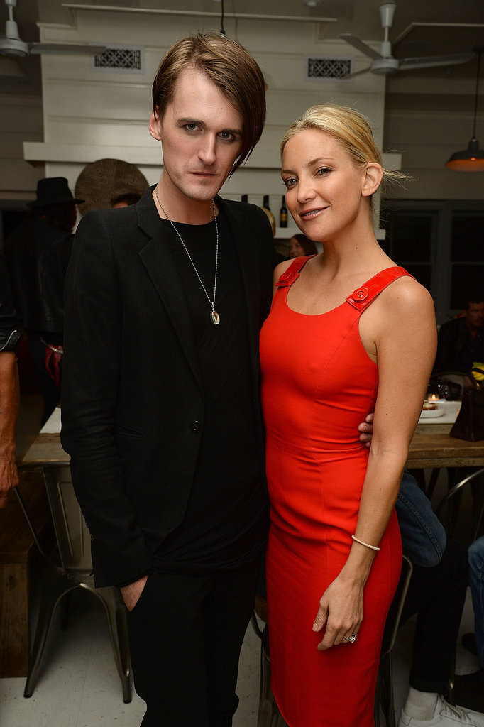 Later in the day, Kate Hudson posed with designer Gareth Pugh at a dinner hosted in his honor.