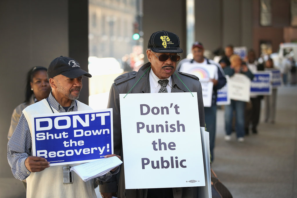 Federal employees in Chicago protested in a demonstration organized by Rev. Jesse Jackson.