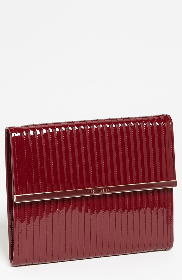 Clutch or quilted iPad sleeve ($90)? Both! The sleek patent shine and beautiful burgundy color give way to a practical case for all iPad models.