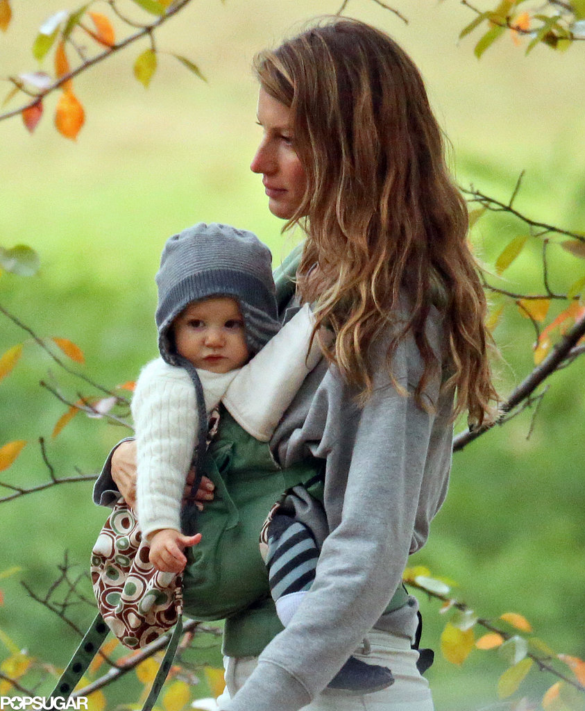Gisele Bündchen held on to Vivian Brady in her carrier.