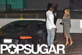 Kanye West held the Lamborghini door open for Kim Kardashian.