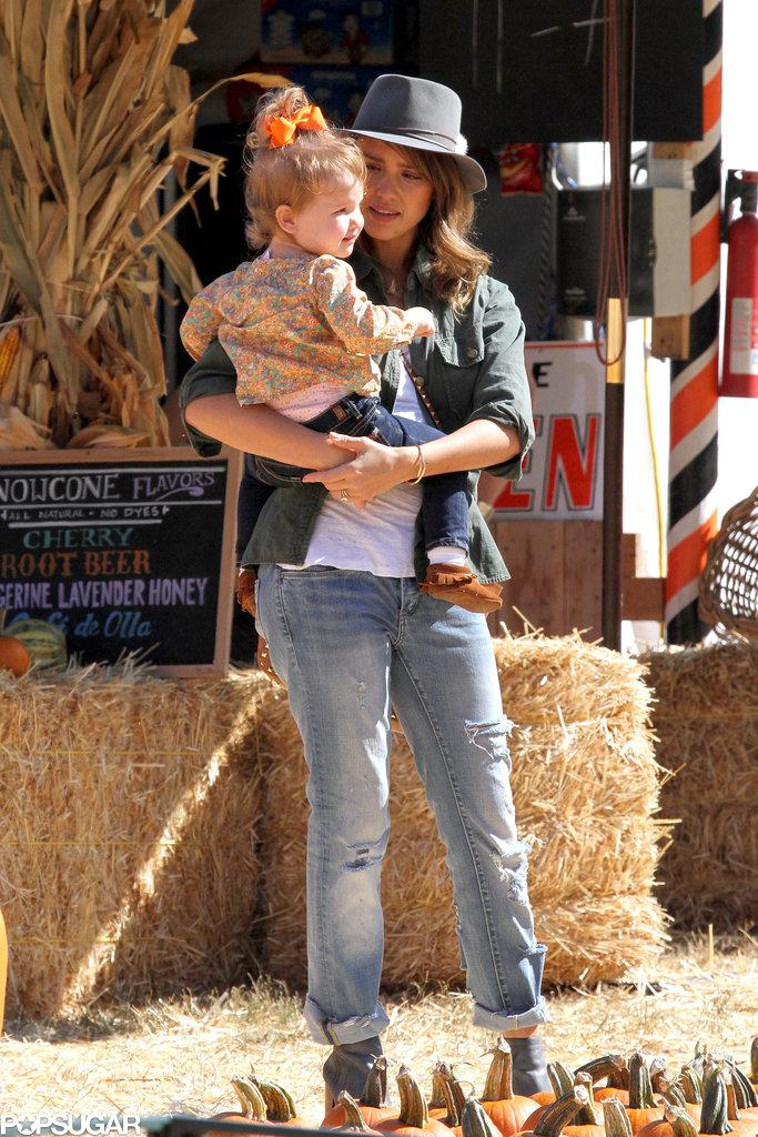 Jessica Alba held on to her daughter Haven Warren at the pumpkin patch in LA.
