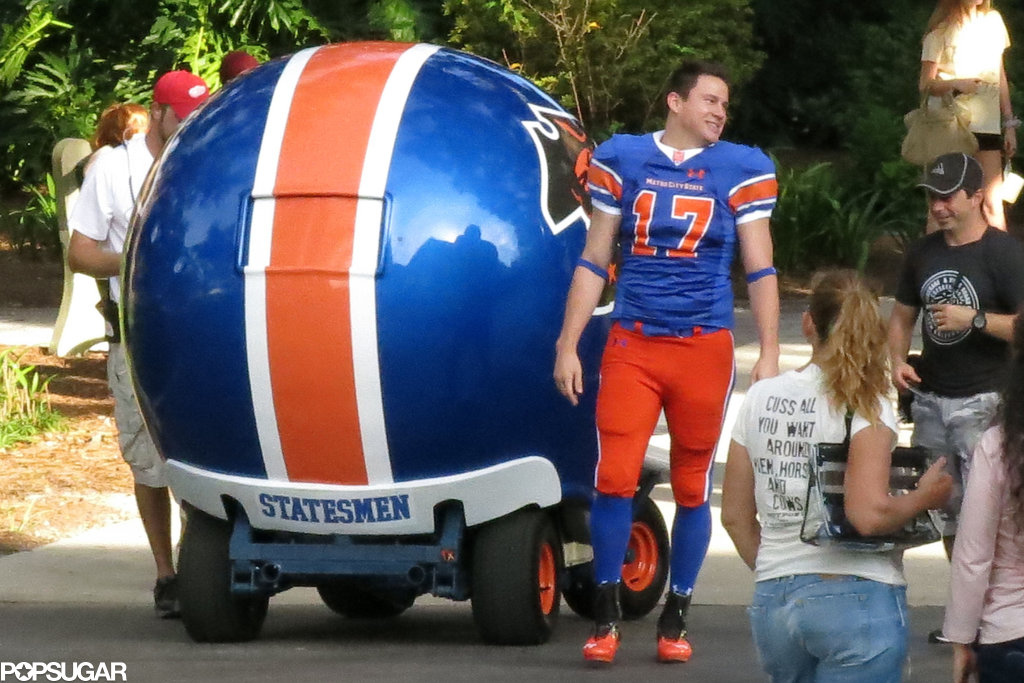 Channing Tatum suited up in football gear on the set.