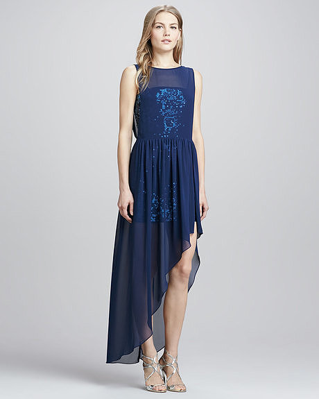 A midnight-blue hue and a touch of embellishment make this BCBG Max Azria asymmetric chiffon-veiled sequin gown ($368) perfect for your dressier weddings.