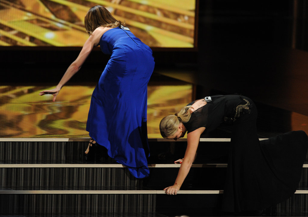 Tina Fey and Amy Poehler got a lot of laughs at the 2013 Emmy Awards by rolling up the stairs.