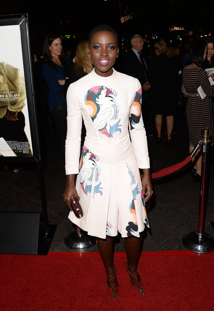 Lupita Nyong made a colorful arrival for the LA premiere of 12 Years a Slave in a printed Miu Miu dress,  Kwiat jewels, and cap-toe Christian Louboutin T-straps.
