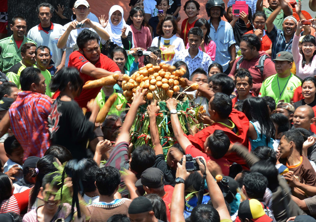 In Indonesia, people rushed toward an offering from the King of Yogjakarta, which is believed to bring a blessing.
