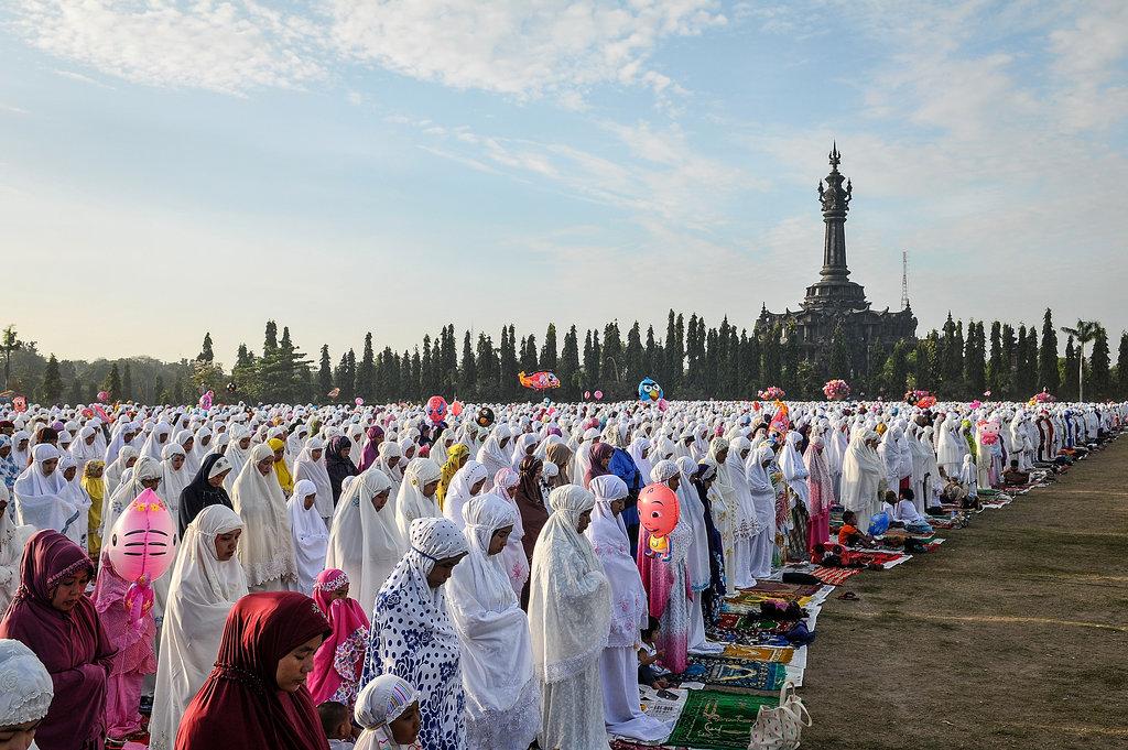 "In Indonesia, thousands of Muslims prayed together for Eid al-Adha, also called the ""Feast of the Sacrifice."""