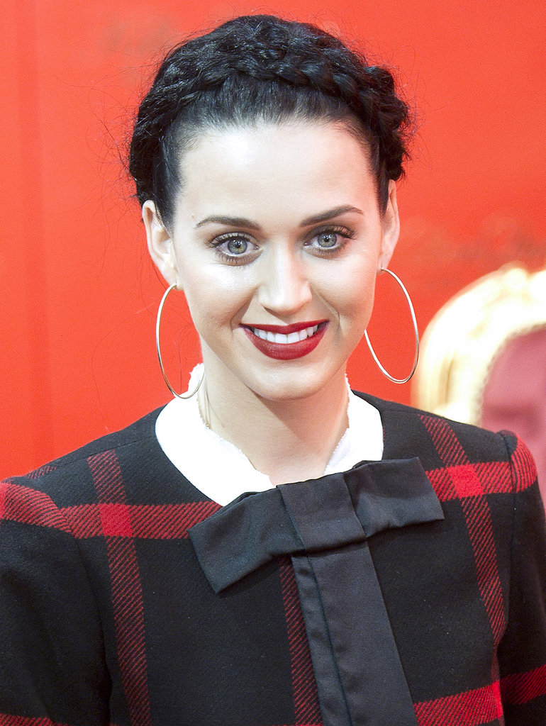 Katy Perry showed that you can work a milkmaid braid — even in the colder months. Elevate the typically summery style by throwing on a classic red lipstick.