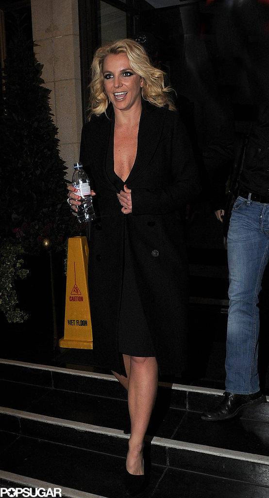 Britney Spears left her London hotel in a low-cut dress.