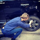 Karlie Kloss learned how to change a tire. Source: Instagram user karliekloss