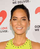Olivia Munn went with neutral warm tones from bronzed lids to a peach lip to balance the neon hue of her dress.