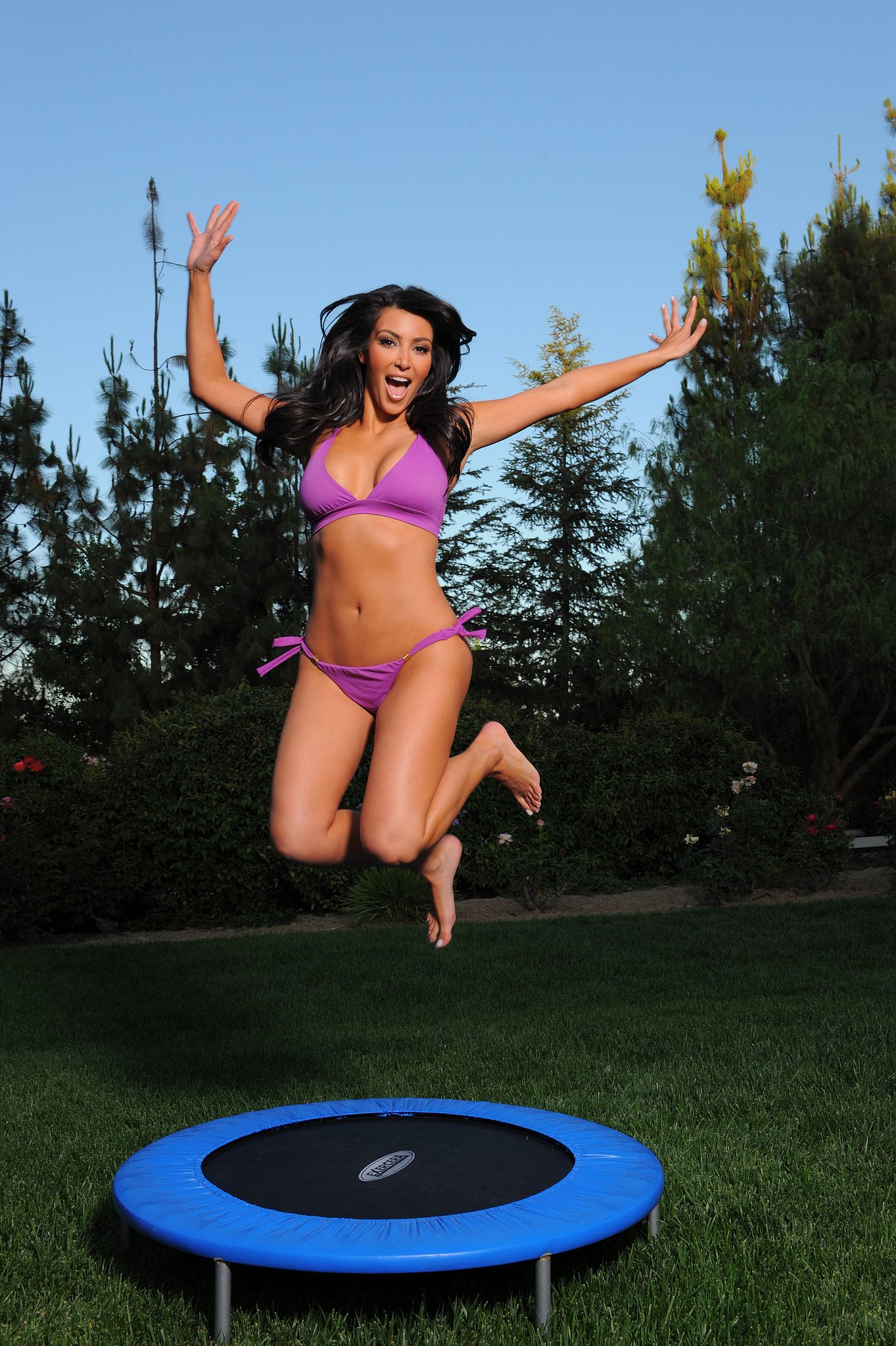 Kim Kardashian got silly on a trampoline during a July 2009 photo shoot in LA.