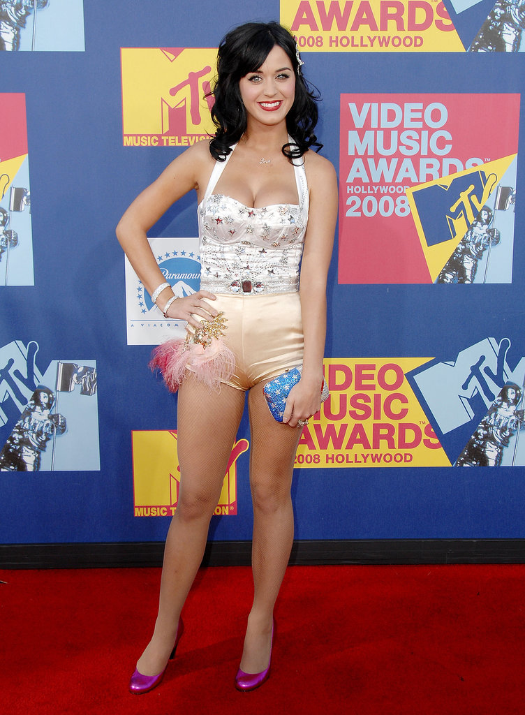 The 2008 MTV Movie Awards brought out the playful side of Perry in a colorblock halter bodysuit with plume details and starburst adornments.