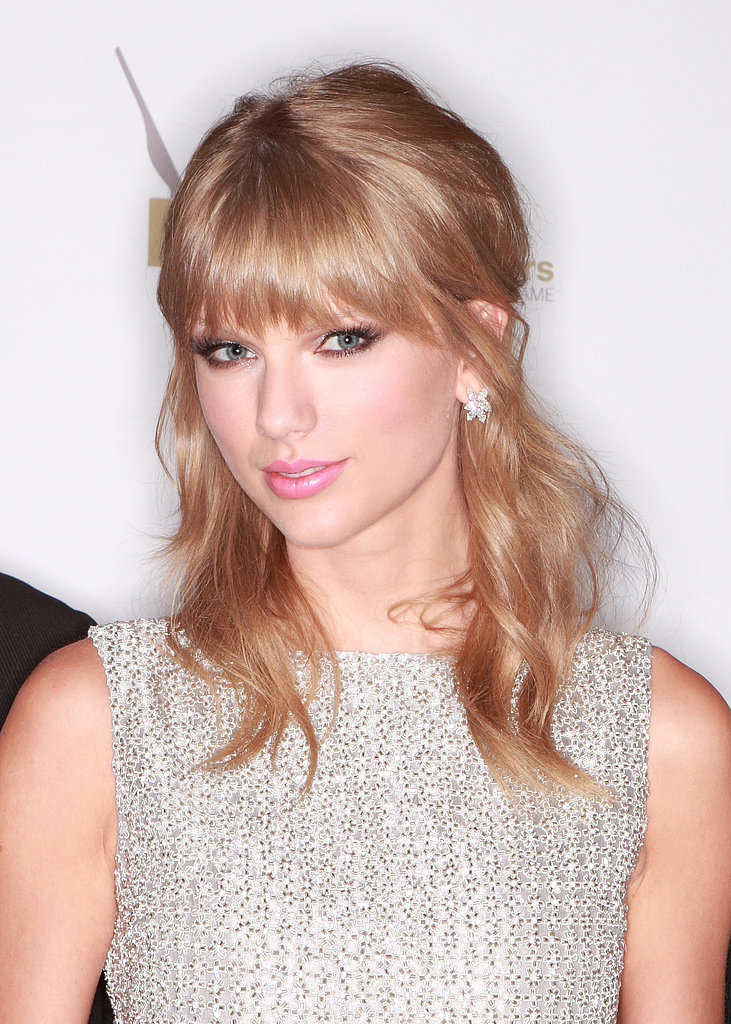 Taylor Swift was named artist of the year by the Nashville Songwriters Association earlier this week. She accepted her award with a half-up hairstyle and flirty pink makeup.