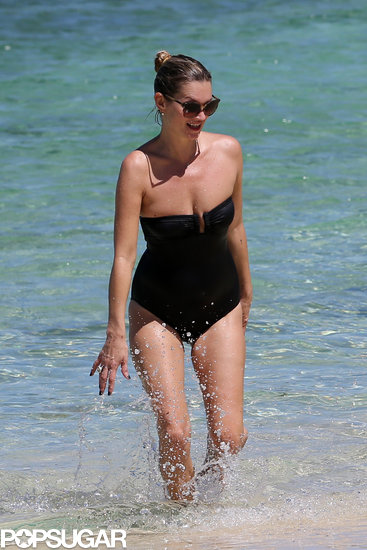 Kate Moss switched to a chic black one-piece while swimming in Jamaica.