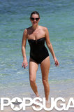 Kate Moss smiled while walking in the water.