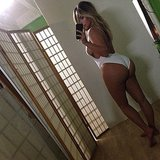 "Kim Kardashian flaunted her post-baby body in this skimpy one-piece and captioned the picture, ""#NoFilter."" Source: Instagram user kimkardashian"