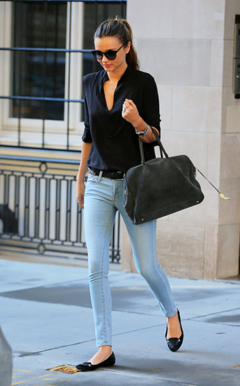 Miranda kept things simple and chic in a navy blouse, which she tucked into a pair of faded jeans. Polished flats and a suede bag finished off her weekend look.