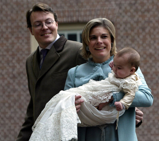 Princess Laurentien of the Netherlands and Prince Constantijn held up their daughter Countess Eloise of Orange-Nassau for her christening in the Netherlands on Dec. 15, 2002.