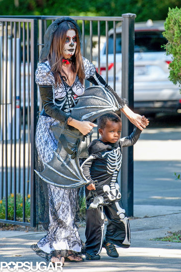 Sandra Bullock was in full Day of the Dead garb as she took her little skeleton Louis to a costume party in LA.