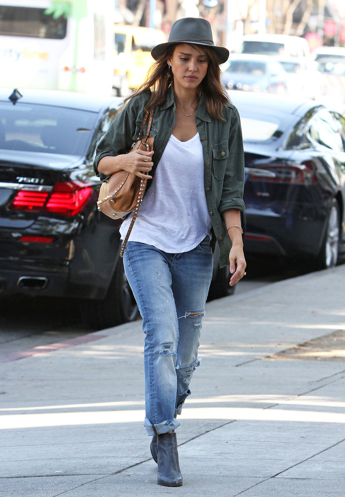Jessica Alba ran errands looking cool in these Blank NYC The Galaxy jeans ($88), which she matched with a studded bag, leather booties, a white tee, and an army blouse.