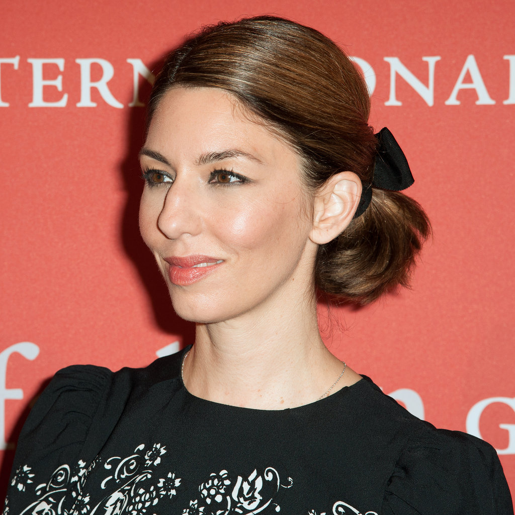 Everything is better when tied with a bow. Last night, Sofia Coppola embellished her short ponytail with a barrette, keeping her makeup sweet and simple.