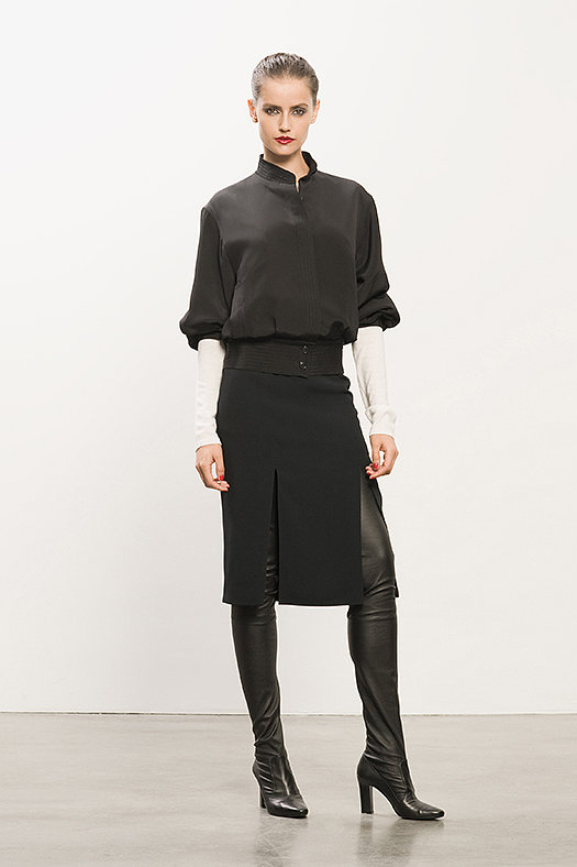 Bomber Black Jacket ($695), Cashmere Cream Sheer Sweater ($395), Double Slit Black Pencil Skirt ($450), Erotic Dream Black Leather Thigh High Boot ($1,350) P