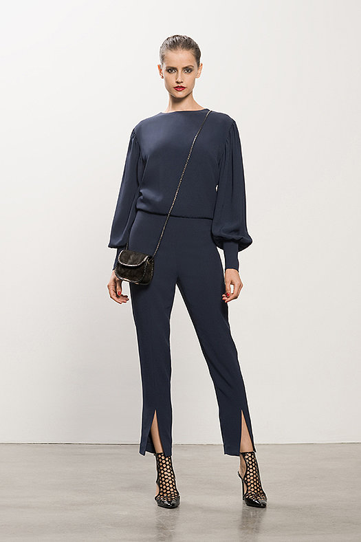 Crepe Navy Jumpsuit ($995), Secret Place Black Open Back Bootie ($895), Treasure Black Suede Cross Body Bag ($650) Photo courtesy of Tamara Mellon