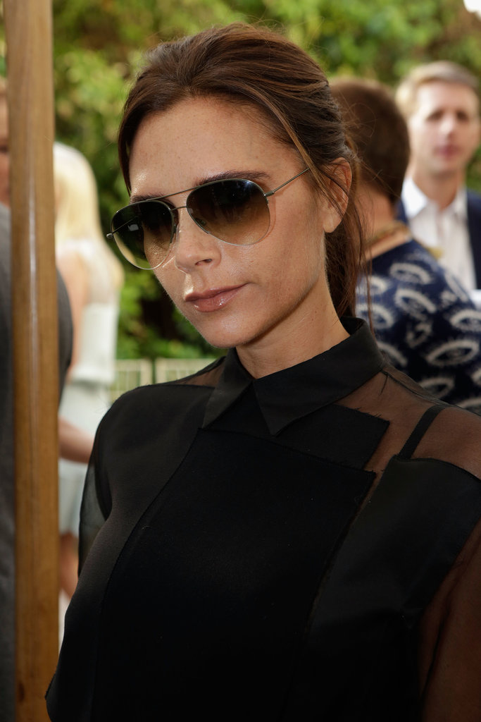Going for a standard, Victoria Beckham swept her hair into a loose ponytail and kept her makeup neutral.