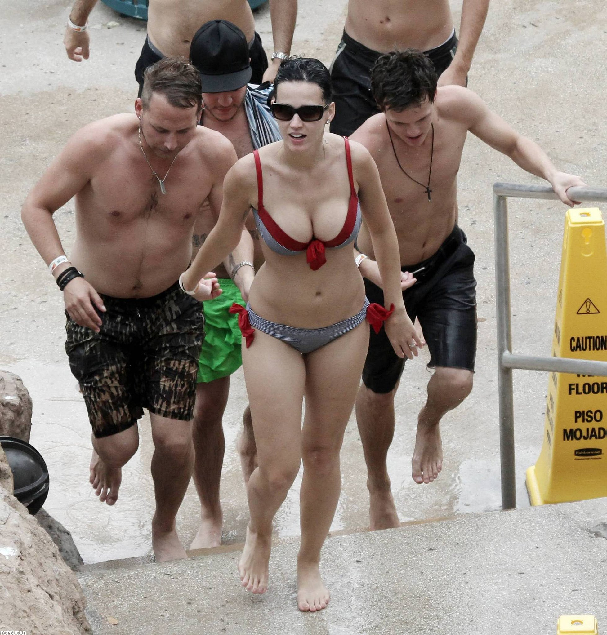 Katy Perry hit the beach in the Bahamas in July 2010 wearing a bikini with red ties.