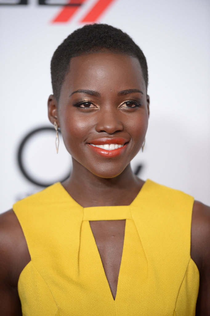 We've fallen in love with 12 Years a Slave actress Lupita Nyong'o ever since she hit the red carpet to promote her film. This week, we saw her play with a warm makeup palette with gold on her eyes and a red-orange lipstick.
